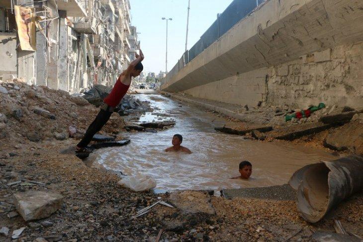 AFP PHOTO/AMC/FADI AL-HALABI