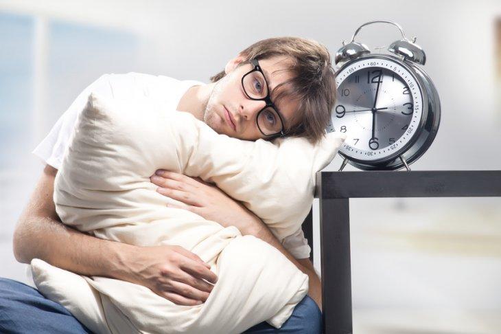 Sad man holding pillow (CC)