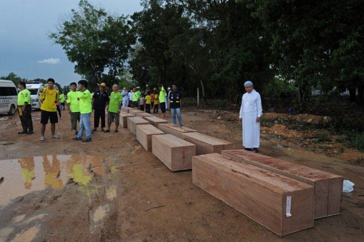 Cadáveres de migrantes encontrados en fosas | AFP