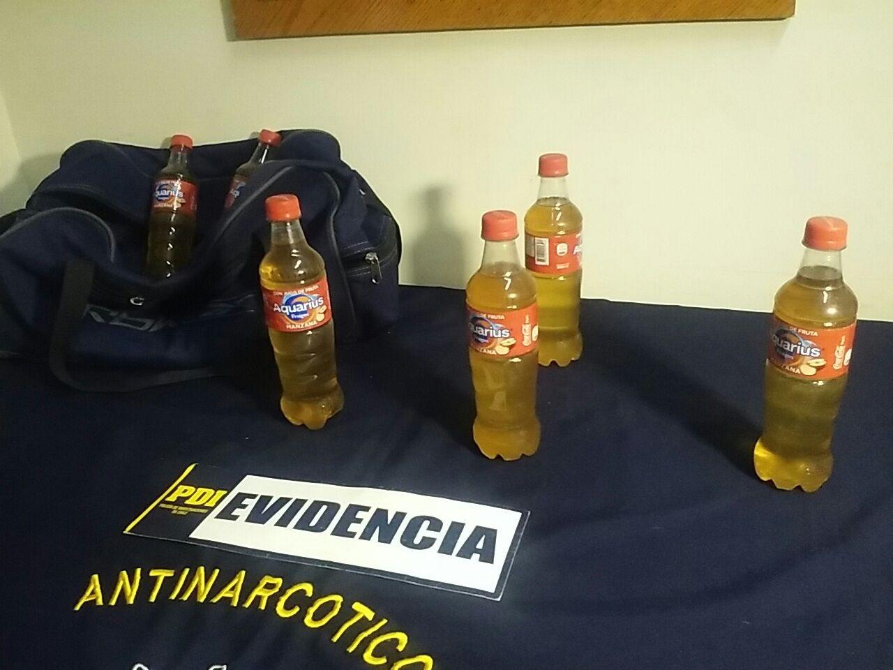 Droga líquida en botellas de jugo