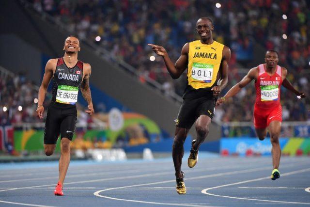 Bolt y De Grasse | Agence France-Presse
