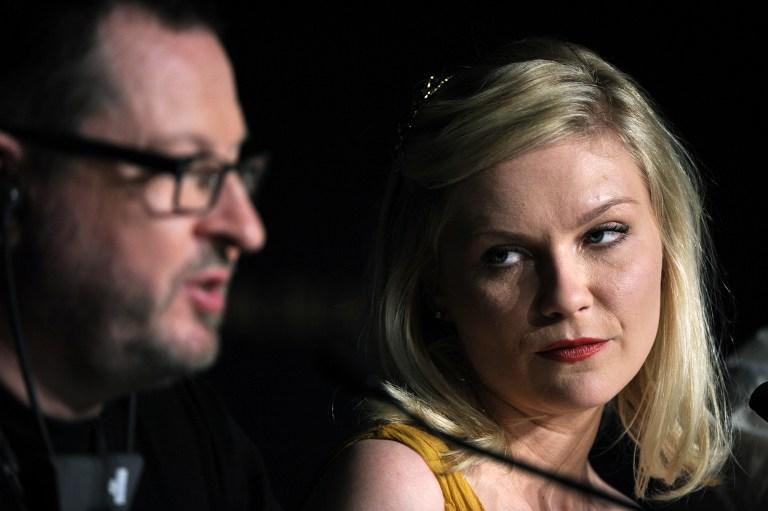 Lars Von Trier y Kirsten Dunst, en la polémica rueda de prensa de Cannes 201 | AFP | Anne-Christine Poujoulat