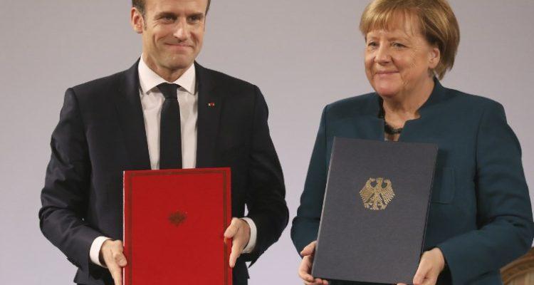 Merkel y Macron firman nueva alianza franco-alemán pese a críticas de grupos nacionalistas