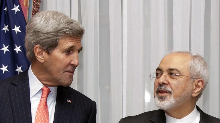 John Kerry junto a Zarif | Brian Snyder | Pool | AFP