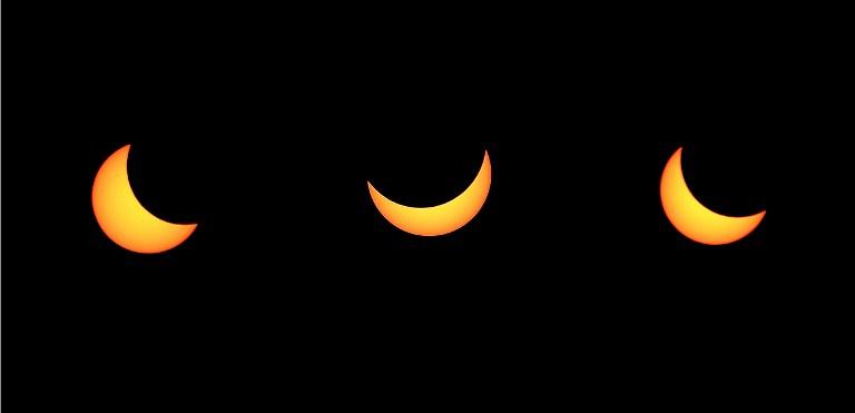 Tres fotos del eclipse en Estrasburgo, Francia / AFP