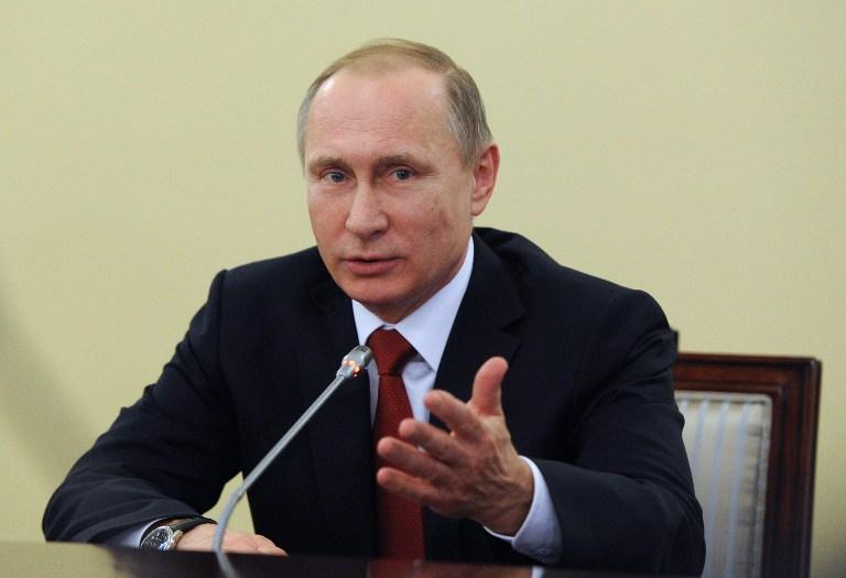 MIKHAIL KLIMENTYEV | SPUTNIK | AFP PHOTO