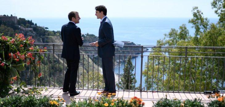 Justin Trudeau (derecha) y Emmanuel Macron (izquierda) | Stephane de Sakutin | Pool | AFP