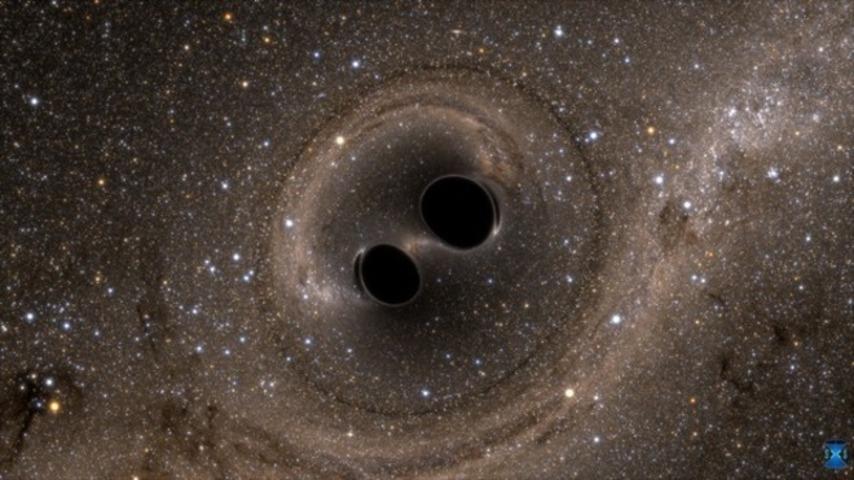 Representación de dos agujeros negros | LIGO