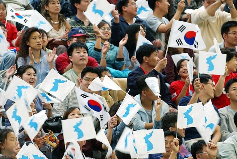 Bandera de la Unificación Coreana en los 14º Juegos Asiáticos en Busan en 2002 | Emmanuel Dunand | AFP