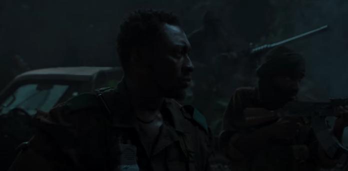Bambadjan Bamba (al centro) en Black Panther (2018)