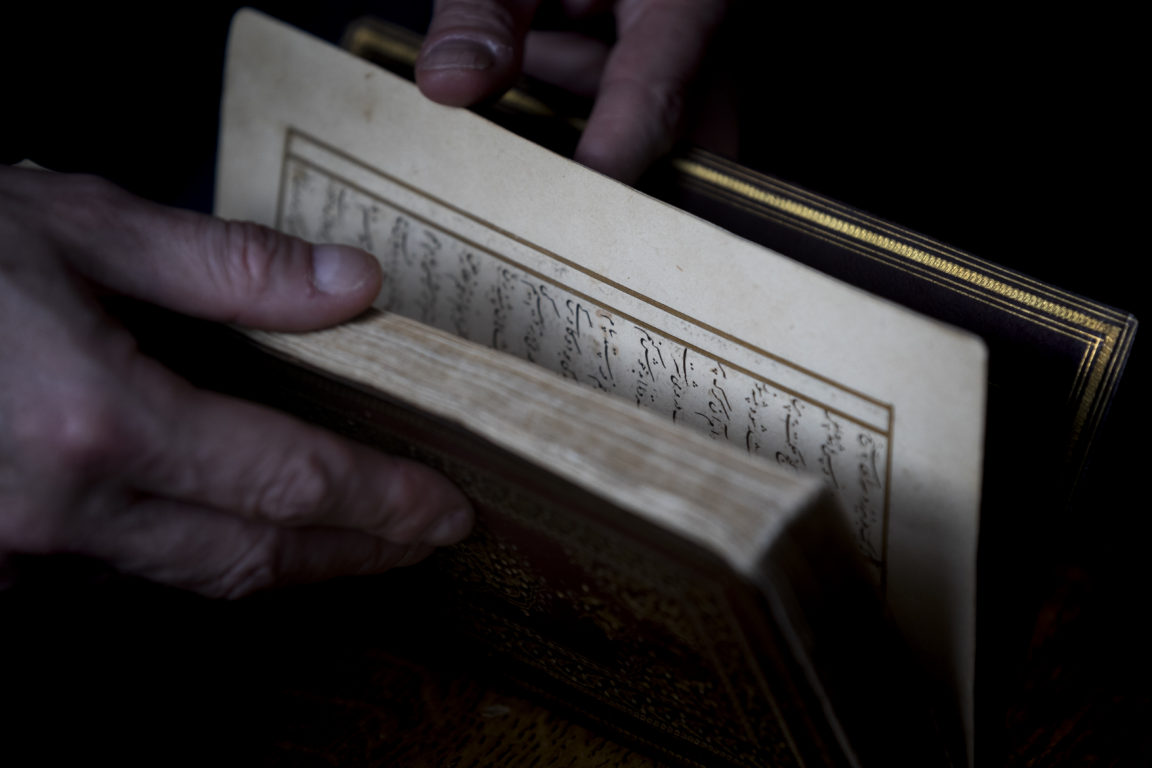"A picture taken on January 16, 2020 at the apartment of Dutch art crime investigator Arthur Brand in Amsterdam shows a rare 15th-century book of poems by Shams-ud-din Muhammad Hafiz's ""Divan"". - A stolen 15th-century book by the famed Persian poet Hafez has been recovered by a Dutch art detective after an international ""race against time"" that drew the alleged interest of Iran's secret service. The gold-leafed volume worth around one million euros ($1.1 million) was found to be missing from the collection of an Iranian antiques dealer after his death in Germany in 2007. (Photo by Kenzo TRIBOUILLARD / AFP)"